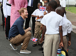 Prince Harry arrives at a community sports event at Queens Park Grounds in Grenada, during the second leg of his Caribbean tour.