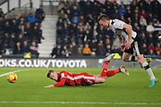 Derby County defender Alex Pearce (16) fouls Cardiff City forward Rhys Healey (37) and is awarded a penalty during the EFL Sky Bet Championship match between Derby County and Cardiff City at the Pride Park, Derby, England on 14 February 2017. Photo by Jon Hobley.
