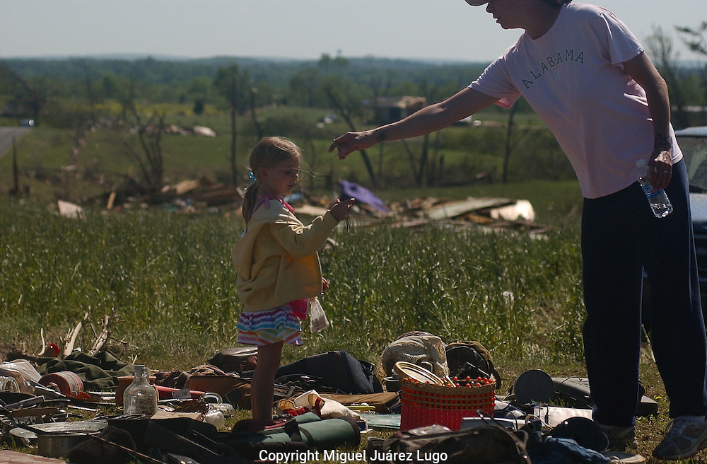 Rainsville, Alabama: Karmen Sparks plays with her daughter Joslyn, 6, in the ruins of her uncle's house Friday. Her aunt was flung from the house when a tornado hit Wednesday. At least 32 people are confirmed dead in northeast Alabama's Dekalb County, and many of those were in Rainsville. (PHOTO: MIGUEL JUAREZ LUGO)