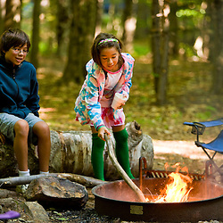 A boy and his sister enjoy a morning camp fire in New Hampshire's Monadnock State Park.