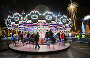 The Holiday Carousel in Westlake Park lights the night Friday night during the Great Figgy Pudding Caroling Competition. (Dean Rutz / The Seattle Times)