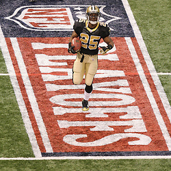 16 January 2010:  New Orleans Saints running back Reggie Bush (25) runs across a playoff banner painted on the field on the field prior to kickoff against the Arizona Cardinals for the 2010 NFC Divisional Playoff game at the Louisiana Superdome in New Orleans, Louisiana.