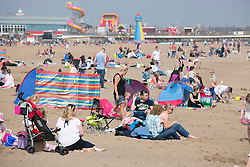 © Licensed to London News Pictures. 10/4/2015. Skegness, Lincolnshire, UK.<br /> People enjoying the warmest day of the year so far in the holiday resort of Skegness. Pictured, the busy beach and sea front. Photo credit : Dave Warren/LNP