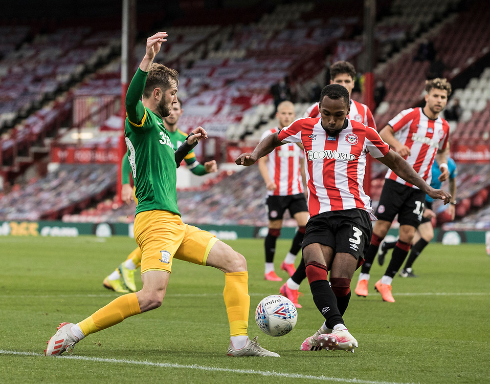 Preston North End's Tom Barkhuizen competing with Brentford's Rico Henry (right) <br /> <br /> Photographer Andrew Kearns/CameraSport<br /> <br /> The EFL Sky Bet Championship - Brentford v Preston North End - Wednesday 15th July 2020 - Griffin Park - Brentford <br /> <br /> World Copyright © 2020 CameraSport. All rights reserved. 43 Linden Ave. Countesthorpe. Leicester. England. LE8 5PG - Tel: +44 (0) 116 277 4147 - admin@camerasport.com - www.camerasport.com