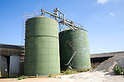 Two green cereal silos in farmyard Hollesley, Suffolk, England
