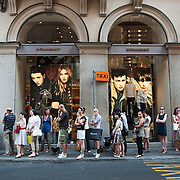MILAN, ITALY - JULY 03:  Shoppers queue in front of the Burberry's store in the fashion district of Milan on the first day of the Summer Sales on July 3, 2010 in Milan, Italy. Milan's summer sales start today. .***Agreed Fee's Apply To All Image Use***.Marco Secchi /Xianpix. tel +44 (0) 207 1939846. e-mail ms@msecchi.com .www.marcosecchi.com