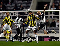 Photo: Jed Wee.<br /> Newcastle United v Fenerbahce. UEFA Cup. 19/10/2006.<br /> <br /> Fenerbahce's Edu (C) beats Newcastle's flailing Antoine Sibierski (R) to the ball.