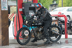 Doug Wothke of Alabama, an experienced long distance rider who has ridden a 1948 Indian Chief around the world as well as a 1962 Panhead chopper around the world, here at a rainy gas stop with his 1916 Indian during the Motorcycle Cannonball Race of the Century. Stage-11 ride from Durango, CO to Page, AZ. USA. Wednesday September 21, 2016. Photography ©2016 Michael Lichter.