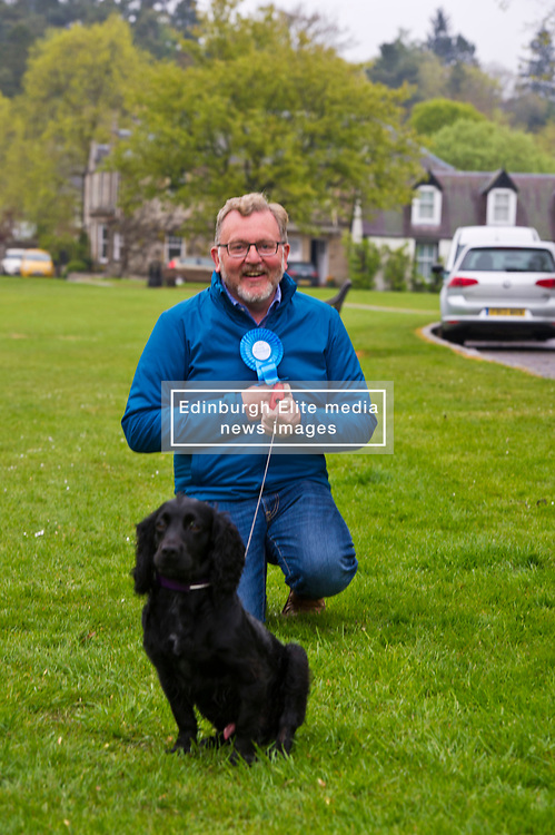 Pictured: David Mundell and Wilson, Ruth Davidson's dog. Ms Davidson asked them to 'stay' and they did.<br /> <br /> Scottish Tory leader Ruth Davidson and Scottish Secretary David Mundell took to the campaign trail in West Linton today.<br /> <br /> Ger Harley | EEm 13 May 2017