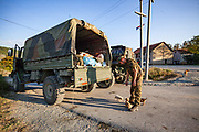 KFOR Troops are seen nearby a blockade checkpoint formed by the local Serbs who are maintaining blockades of two bridges in the city of Mitrovica, in the north of Kosovo, Oct 3, 2011. (Photo/ Vudi Xhymshiti)