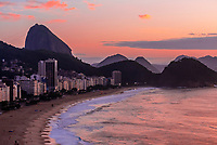 Predawn view over Avenida Atlantica and Copacabana Beach, with Sugarloaf Mountain in background, Rio de Janiero, Brazil.