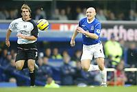 Photo: Chris Brunskill. Everton v Fulham. Barclays Premiership. 20/11/2004. Thomas Gravesen of Evrton chases for the ball with Carlos Bocanegra of Fulham.