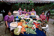 The Mendoza family and a servant in their courtyard in Todos Santos Cuchumatán, Guatemala, with a week's worth of food. Between Fortunato Pablo Mendoza, 50, and Susana Pérez Matias, 47, stand (left to right) Ignacio, 15, Cristolina, 19, and a family friend (standing in for daughter Marcelucia, 9, who ran off to play). Far right: Sandra Ramos, 11, live-in helper. Not present: Xtila, 17, and Juan, 12. From the book Hungry Planet: What the World Eats (Model Released)