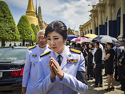 October 14, 2016 - Bangkok, Bangkok, Thailand - YINGLUCK SHINAWATRA, the former Prime Minister of Thailand, leaves the Sahathai Samakom Pavilion at the Grand Palace after paying respects to Bhumibol Adulyadej, the King of Thailand, who died Oct. 13, 2016. Yingluck's government was overthrown by a military coup in 2014. He was 88. His death comes after a period of failing health. With the king's death, the world's longest-reigning monarch is Queen Elizabeth II, who ascended to the British throne in 1952. Bhumibol Adulyadej, was born in Cambridge, MA, on 5 December 1927. He was the ninth monarch of Thailand from the Chakri Dynasty and is known as Rama IX. He became King on June 9, 1946 and served as King of Thailand for 70 years, 126 days. He was, at the time of his death, the world's longest-serving head of state and the longest-reigning monarch in Thai history. (Credit Image: © Jack Kurtz via ZUMA Wire)