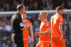 Referee Mr Carl Boyeson has words with Blackpool's defender David Perkins  - Photo mandatory by-line: Mitchell Gunn/JMP - Tel: Mobile: 07966 386802 29/03/2014 - SPORT - FOOTBALL - Loftus Road - London - Queens Park Rangers v Blackpool - Championship