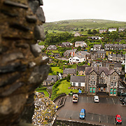 View of the won and parking lot from the ramparts at Harlech Castle in Harlech, Gwynedd, on the northwest coast of Wales next to the Irish Sea. The castle was built by Edward I in the closing decades of the 13th century as one of several castles designed to consolidate his conquest of Wales.