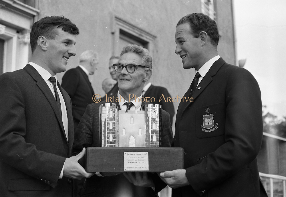 21/08/1967<br /> 08/21/1967<br /> 21 August 1967<br /> Blackrock RFC press conference to announce 2nd Annual Festival of Rugby at Stradbrook Road, Blackrock, Dublin. Pictured with the Castle Trophy are: Mr. Dermot Roughen, (left), Captain B.C.R.F.C.; Mr Michael Vaughan, (centre) Acting President of the Club and Mr. Noel Turley, Chairman, Festival Committee.