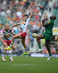 Harlequins replacement Ollie Lindsay-Hague and London Irish Winger Topsy Ojo miss the ball. - Photo mandatory by-line: Alex James/JMP - 07966 386802 - 06/09/2014 - SPORT - RUGBY UNION - London, England - Twickenham Stadium - Saracens v Wasps - Aviva Premiership London Double Header.