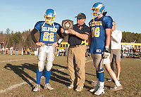 Captain James Seager, Coach Mark Brewer and Captain Brendan Demo accept the runner up trophy on behalf of their team during the NHIAA Division VI football state championship game played against Newport Saturday afternoon.  (Karen Bobotas/for the Laconia Daily Sun)