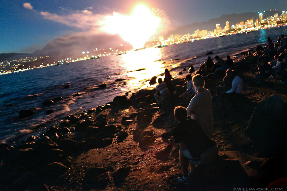 Spectators watch the 2010 Celebration of Light contest, where teams from different countries compete with firework shows set to music on Vancouver's English Bay.