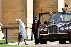 Queen Elizabeth II the Duke of Edinburgh arrive for the wedding of Princess Eugenie to Jack Brooksbank at St George's Chapel in Windsor Castle.
