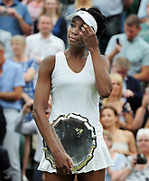 Tennis - 2017 Wimbledon Championships - Week Two, Saturday [Day Twelve]<br /> <br /> Ladies Singles,  Final match<br /> <br /> Garbine Muguruza (ESP) vs. Venus Williams  (USA)<br /> <br /> Venus Williams reflects with her runners up plate on  Centre court <br /> <br /> COLORSPORT/ANDREW COWIE