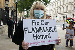 Leaseholders and tenants living in unsafe homes protest opposite Downing Street on 15th July 2021 in London, United Kingdom. Some leaseholders are faced with crippling costs to fix safety issues and they called on the government to ensure that their homes are made safe from fire as a matter of priority, to make interim payments and to cover fire safety remediation costs and to find a solution with mortgage lenders which enables them to move on with their lives. Speakers also called for justice for the survivors and victims of the Grenfell fire.