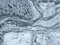 Top aerial view of Beas river by the pine trees forest in Manali city of Himachal pradesh of India.