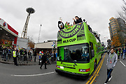 Seattle Sounders midfielder and captain Nicolas Lodeiro, left, holds up the MLS Cup trophy, as he rides with teammates, including goalkeeper Stefan Frei, right, as they ride past the Space Needle during the MLS Cup Champions Parade & Rally on November 12, 2019 in Seattle, Washington, to celebrate the Sounders' win over Toronto FC to win the MLS Cup soccer match in Seattle. (Alika Jenner/Image of Sport)