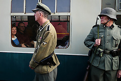 © Licensed to London News Pictures. <br /> 15/10/2016. <br /> Levisham, UK.  <br /> <br /> Re-enactors dressed as German soldiers stand on the platform at Levisham station during the North Yorkshire Moors Railway Wartime Weekend event. <br /> The annual event brings together re-enactors and enthusiasts along the length of the NYMR heritage steam railway line to recreate the feel of the war years of the 1940's. <br /> <br /> Photo credit: Ian Forsyth/LNP