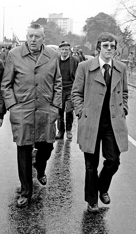 Rev Ian Paisley and a youthful Peter Robinson taking part in UUAC strike march on the Newtownards Road, Belfast, N Ireland.  197505000175h.<br /> <br /> Copyright Image from Victor Patterson, Belfast, UK<br /> <br /> t: +44 28 9066 1296 (from Rep of Ireland 048 9066 1296)<br /> m: +44 7802 353836<br /> e: victorpattersonbelfast@gmail.com<br /> <br /> www.images4media.com<br /> <br /> Please see my full Terms and Conditions of Use at https://www.images4media.com/p/terms-conditions - it is IMPORTANT that you familiarise yourself with them.<br /> <br /> Images used online incur an additional cost. This cost should be agreed in writing in advance. Online images must be visibly watermarked i.e. © Victor Patterson or that of the named photographer within the body of the image. The original metadata must not be deleted from images used online.<br /> <br /> This image is only available for the use of the download recipient i.e. television station, newspaper, magazine, book publisher, etc, and must not be passed on to a third party. It is also downloaded on condition that each and every usage is notified within 7 days to victorpattersonbelfast@gmail.com.<br /> <br /> The right of Victor Patterson (or the named photographer) to be identified as the author is asserted in accordance with The Copyright Designs And Patents Act (1988). All moral rights are asserted.