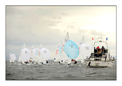 470 Class European Championships Largs - Day 1.Racing in grey and variable conditions on the Clyde...Finish line of Men's Fleet