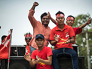 25 OCTOBER 2015 - SHWEPYITHAR, MYANMAR: National League for Democracy activists in Shwepyithar, Myanmar, ride on a sound truck during a political rally and motorcade in the small town about 90 minutes from Yangon. Political parties are in fill campaign mode in Myanmar (Burma). National elections are scheduled for Sunday Nov. 8. The two principal parties are the National League for Democracy (NLD), the party of democracy icon and Nobel Peace Prize winner Aung San Suu Kyi, and the ruling Union Solidarity and Development Party (USDP), led by incumbent President Thein Sein. There are more than 30 parties campaigning for national and local offices.     PHOTO BY JACK KURTZ