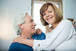 Couple in bed, smiling