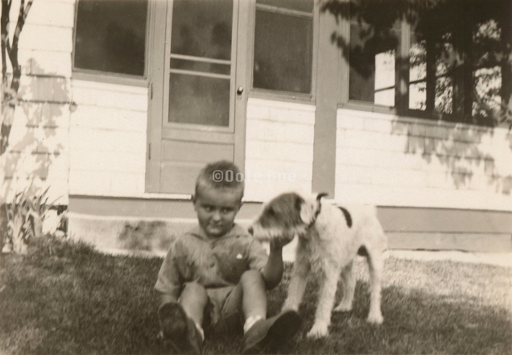A little boy with his dog