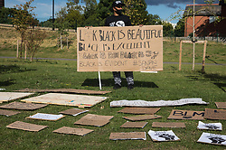 Slough, UK. 13 June, 2020. Local people take part in a peaceful protest in solidarity with the Black Lives Matter movement in Salt Hill Park. Protests in solidarity with the Black Lives Matter movement have taken place across the United States and in many countries around the world.