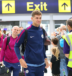 John Stones as the Manchester City team arrive at Manchester Airport as they jet for Iceland