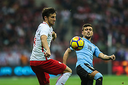November 10, 2017 - Warsaw, Poland - Bartosz Bereszynski (POL), Giorgian de Arrascaeta (URU) in action during the international friendly match between Poland and Uruguay at National Stadium on November 10, 2017 in Warsaw, Poland. (Credit Image: © Foto Olimpik/NurPhoto via ZUMA Press)