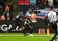 American Football - 2019 NFL Season (NFL International Series, London Games) - Houston Texans vs. Jacksonville Jaguars<br /> <br /> Carlos Hyde, Running Back, (Houston Texans) fumbles the ball only yards from the line at Wembley Stadium.<br /> <br /> COLORSPORT/DANIEL BEARHAM