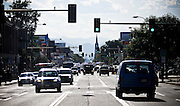 """SHOT 8/19/09 5:27:31 PM - Colfax Avenue is the main street that runs east and west through the Denver-Aurora metropolitan area in Colorado. As U.S. Highway 40, it was one of two principal highways serving Denver before the Interstate Highway System was constructed. In the local street system, it lies 15 blocks north of the zero point (Ellsworth Avenue, one block south of 1st Avenue). For that reason it would normally be known as """"15th Avenue"""" but the street was named for the 19th-century politician Schuyler Colfax. On the east it passes through the city of Aurora, then Denver, and on the west, through Lakewood and the southern part of Golden. Colloquially, the arterial is referred to simply as """"Colfax"""", a name that has become associated with prostitution, crime, and a dense concentration of liquor stores and inexpensive bars. Playboy magazine once called Colfax """"the longest, wickedest street in America."""" However, such activities are actually isolated to short stretches of the 26-mile (42 km) length of the street. Periodically, Colfax undergoes redevelopment by the municipalities along its course that bring in new housing, trendy businesses and restaurants. Some say that these new developments detract from the character of Colfax, while others worry that they cause gentrification and bring increased traffic to the area. Includes images of the Emporium of Design Tattoo and Piercing Studio, Denver's oldest and most prolific tattoo studio. It opened in 1978 and has produced more award winning tattoo artists than any other tattoo shop in the country.(Photo by Marc Piscotty / © 2009)"""