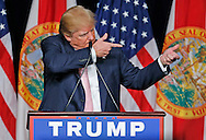 Donald Trump mimics shooting a gun as he talks about a time in US history when military deserters were shot by firing squad. Trump was speaking during his first presidential campaign rally in Florida at the Trump National Doral Miami resort on Friday, October 23, 2015.