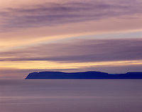 Midnight sun in the Westfjords of Iceland looking towards the Denmark Strait and Hornstrandir