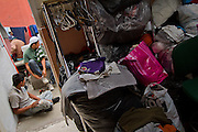 """Clothes donated to the local churches are seen in a room in the migrants shelter """"San Juan Diego Cuauhtlatoatzin"""" Lechería, Estado de México in this file photo, taken on March 30th, 2012. (Photo: Prometeo Lucero)"""
