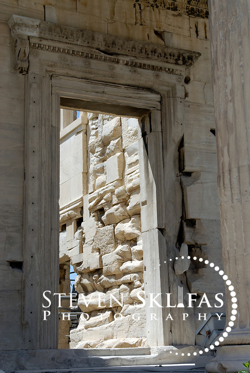 Acropolis. Athens. Greece. View of the richly decorated inner doorway of the North porch portico of the Erechtheion on the Acropolis summit. Built between 420 and 406 BC, the elegant and unusually shaped Temple was designed to incorporate a number of ancient sanctuaries and cults including that of Athena and her olive tree and Poseidon-Erechtheus. The Erechtheion Temple was part of the monumental rebuilding and transformation of the Acropolis buildings during the time of Perikles. The Acropolis of Athens and its monuments are a UNESCO World Heritage Site.