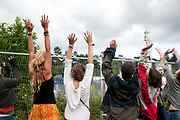 Balcombe, West Sussex. Site of Cuadrilla drilling. Demonstration against fracking 18.08.2013. Protesters surround the site and perform a Mexican wave.