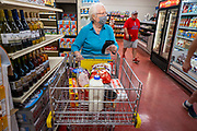 "08 JULY 2020 - JEWELL, IOWA: SHIRLEY ISEBRANDS, a lifelong resident of Jewell, IA, shops in the Jewell Market on the first day it was open. The only grocery store in Jewell, a small community in central Iowa, closed in 2019. It served four communities within a 20 mile radius of Jewell. Some of the town's residents created a cooperative to reopen the store. They sold shares to the co-op and  held fundraisers through the spring. Organizers raised about $225,000 and bought the store, which reopened July 8. Before the reopening, Jewell had been a ""food desert"" for seven months. The USDA defines rural food deserts as having at least 500 people in a census tract living 10 miles from a large grocery store or supermarket. There is a convenience store in Jewell, but it sells mostly heavily processed, unhealthy snack foods that are high in fat, sugar, and salt.         PHOTO BY JACK KURTZ"