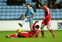 Coventry City's Marc McNulty  and Chesterfield's Jerome Binnom-Williams and Laurence Maguire