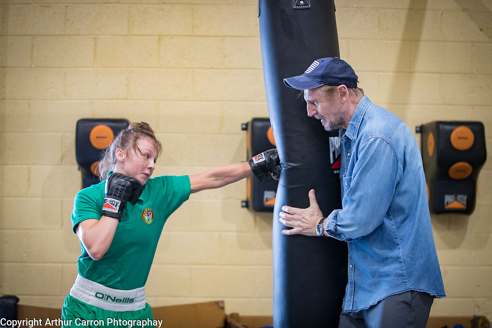 NO FEE PICTURES<br /> 22/7/18 Actor Liam Neeson, who is currently fliming in Northern Ireland, stopped by O'Hanlon Park Amateur Boxing Club, Dundalk today, much to the surprise and delight of local community members. The Club/Community Hall is open to members of the community of all ages - children from seven years of age right through to adults who have reached retirement age. Neeson is a long time friend of Hotelier John Fitzpatrick who has been involved with the boxing club since 2011 when he made a donation to the Club when he participated in The Secret Millionaire show which aired on RTE 1.   Following the broadcast of the programme, John helped raise more than €425,000 through the Eithne & Paddy Fitzpatrick Memorial Fund and the Boxing Club raised over €56,000 including a grant, to enable the Club move to the new building. Pictured Liam Neeson with local boxer Nicole McCabe 17. Picture:Arthur Carron
