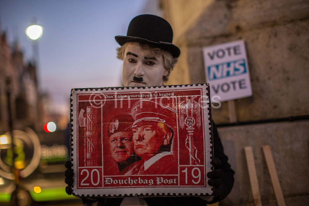 A man dressed as Charlie Chaplin during the Stop Trump Coalition and CND protest against U.S. President Donald Trump UK visit to attend the NATO North Atlantic Treaty Organisation summit on the 3rd December 2019 in London in the United Kingdom. Ahead of a British national election on 12th December 2019, Stop Trump Coalition and CND, Campaign for Nuclear Disarmament organised a protest to target a banquet at Buckingham Palace where Trump will dine with the Queen and other NATO leaders. The U.K. is hosting NATO summit to mark the military alliances 70th anniversary.