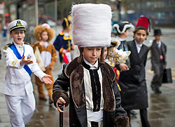 © London News Pictures. 24/03/2016.  Orthodox Jewish children in fancy dress celebrate the festival of Purim in the streets of Stamford Hill in north London. Purim celebrates the miraculous salvation of the Jews from a genocidal plot in ancient Persia, an event documented in the Book of Esther. Traditionally the jewish community wear fancy dress and exchange reciprocal gifts of food and drink. Photo credit: Tolga Akmen/LNP